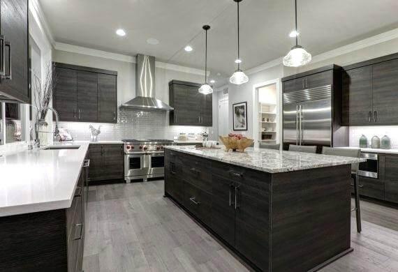 cocinas combinadas de aceros, madera y piedra